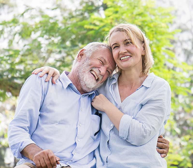 auburn lakes orthodontics spring tx services adults happy couple laughing together in park