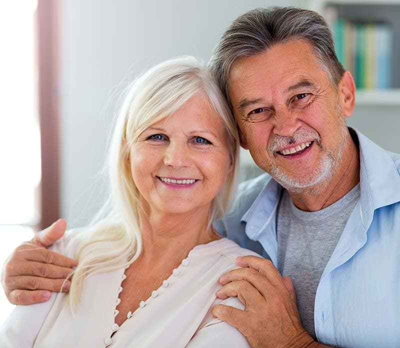 old couple smiling and happy visiting auburn lakes orthodontics