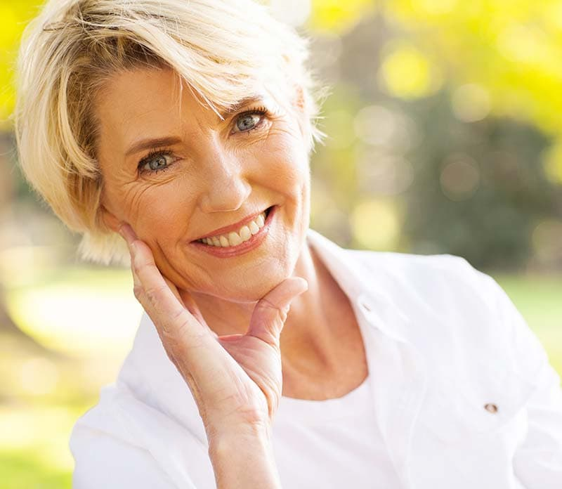 happy woman smiling white and healthy teeth after a visit at auburn lakes orthodontics