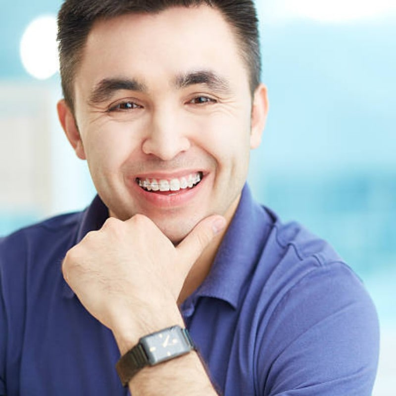 auburn lakes orthodontics spring tx services adults Clear Braces happy man smiling